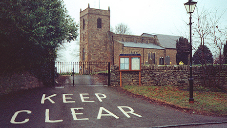 Photo of church with a big keep clear sign outside